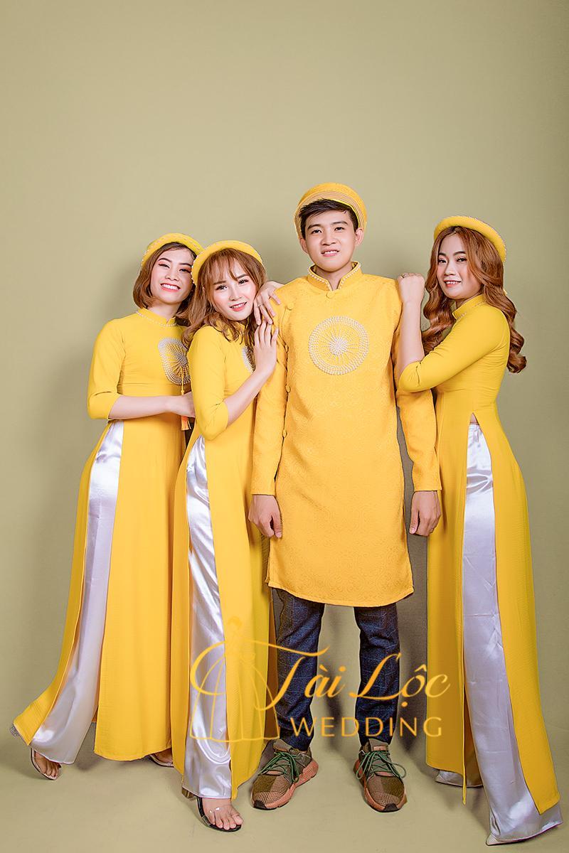 Áo dài bưng quả màu vàng vải thun dây đeo